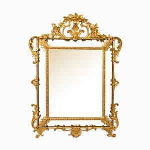 Espejo antiguo con marco de pan de oro