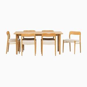 Sedie da pranzo e tavolo in quercia di Niels Otto Møller per J.L. Møllers, Danimarca, anni '50, set di 7