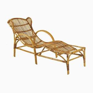 Chaise longue de ratán, años 50