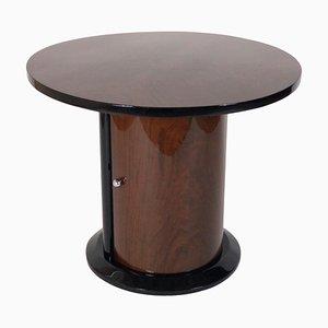 Mesa auxiliar redonda de chapa de nogal, años 30