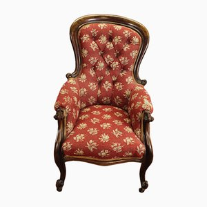 Mahogany Lounge Chair with a Red Floral Pattern