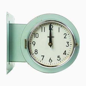 Reloj de dos caras de NHE, años 70