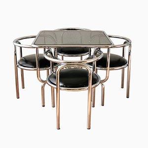 Tavolo da pranzo e sedie di Gae Aulenti per Poltronova, anni '60