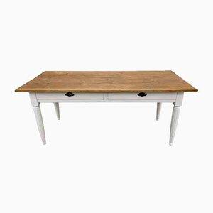 Mesa de comedor antigua con marco blanco