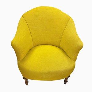 Gelber antiker Sessel