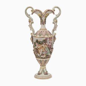Urna de porcelana con dos asas de Capodimonte, años 50