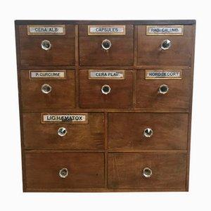 Mueble de farmacia antiguo