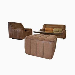 Juego de sofá, butaca y puf de cuero, años 60