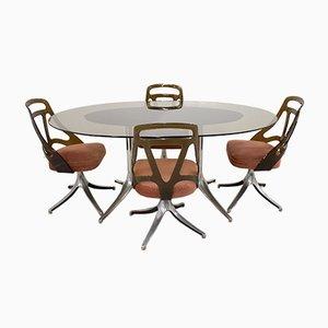 Tavolo da pranzo in vetro con sedie, Italia, anni '60