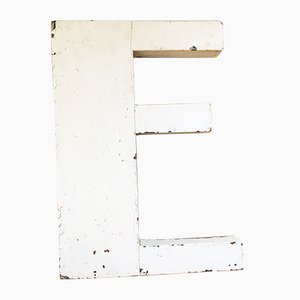 White Letter E Wooden Sign, 1930s