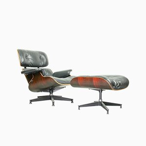 Rosewood Lounge Chair and Stool by Charles & Ray Eames for Herman Miller, 1977, Set of 2