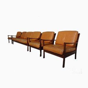 Poltronas de cuero y sofá de palisandro, años 60. Juego de 4