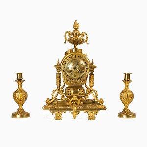 Reloj Luis XVI francés antiguo dorado con candelabros de Japy Fréres. Juego de 3