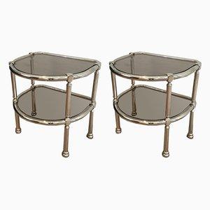 Mesas auxiliares francesas de metal cromado y vidrio, años 70. Juego de 2