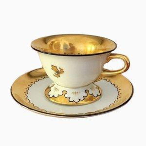 Taza de té alemana de porcelana y platillo de Friedrich Kästner, años 20. Juego de 2
