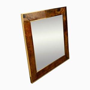 Specchio in ottone e pelle di Aldo Tura, anni '70