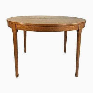 Mesa de comedor extensible redonda de teca de Niels Otto Moller, años 60