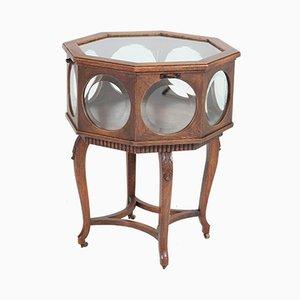 Antiker Teeschrank mit abgeschrägtem Glas