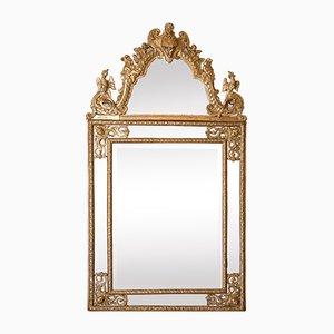 Espejo francés antiguo Regency tallado de madera dorada
