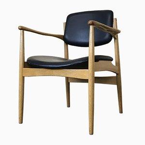 Dänischer Armlehnstuhl aus Eiche, 1960er