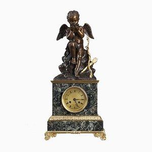 Reloj antiguo de mármol y bronce dorado