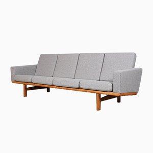 Sofá de tres plazas modelo 236/4 vintage de roble y tela de Hans J. Wegner para Getama, años 60