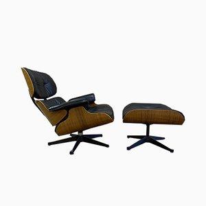 Sessel & Fußhocker aus schwarzem Leder mit Schalen aus Palisander von Charles & Ray Eames für Herman Miller, 1970er