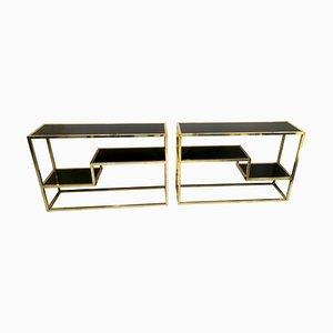 Consolas de latón y vidrio opalino negro, años 70. Juego de 2