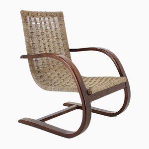 Poltrona reclinabile in legno curvato, anni '50