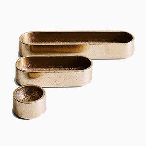 Vassoi in bronzo di Henry Wilson