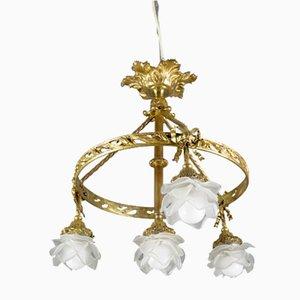 Kronleuchter aus Bronze mit vier Leuchten aus Milchglas, 1920er