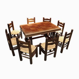 Juego de mesa y sillas de comedor brutalista de roble de Charles Dudouyt, años 40. Juego de 9