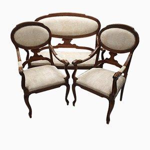 Sofá Louis XVI francés antiguo de roble tallado y butacas. Juego de 3