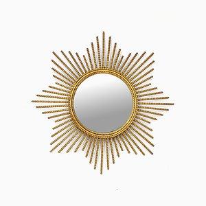 Espejo en forma de sol de metal dorado, años 60