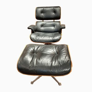 Rosewood Lounge Chair and Footstool by Charles & Ray Eames for Herman Miller, 1950s