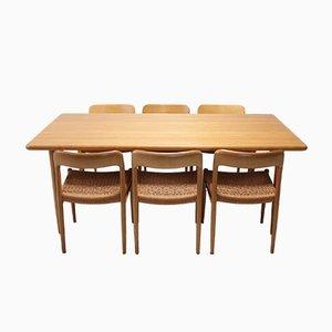 Skandinavisches Set aus Esstisch & Stühlen aus Eiche von Niels Otto Møller für J.L. Møllers, 1970er