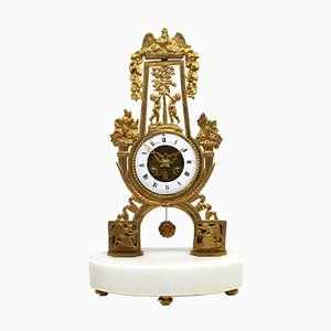 Orologio a pendolo Impero antico in bronzo dorato e marmo