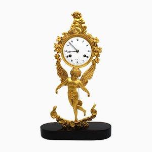 Orologio antico in bronzo dorato e marmo