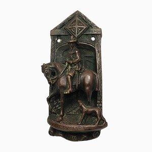 Aldaba antigua de bronce fundido