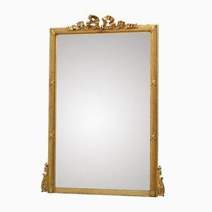 Espejo de pared francés antiguo con marco de madera dorada