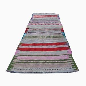 Alfombra de pasillo Kilim anatolia de lana a rayas, años 70