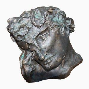 Escultura antigua de bronce