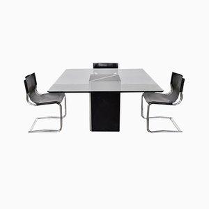 Juego de mesa de comedor y sillas italianas de cuero y vidrio, años 70