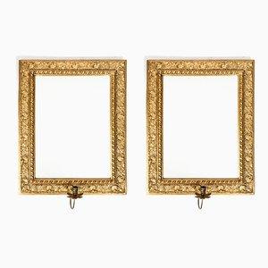 Espejos antiguos de bronce con candelabros. Juego de 2