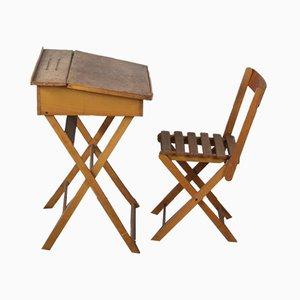 Escritorio infantil Mid-Century y silla plegable. Juego de 2