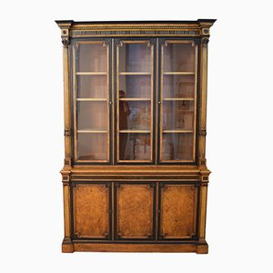 Antique English Empire Style Elm, Ebonized, and Gilded Bookcase