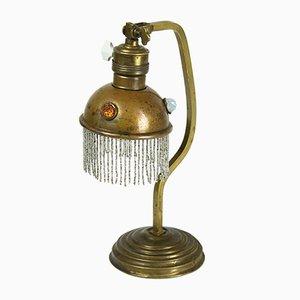 Lámpara de mesa antigua de latón