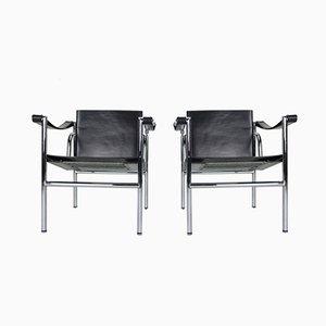 Butacas modelo LC1 de cuero negro de Le Corbusier para Cassina, años 70. Juego de 2