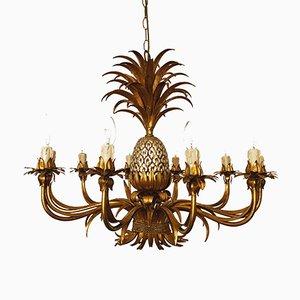 Lámpara de araña piña Hollywood Regency grande dorada de Hans Kögl, años 70
