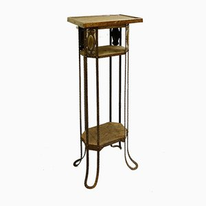 Mesa vintage de metal con pedestal